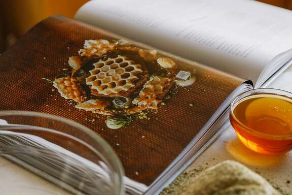 "Ingredients for honey chamomile cake and the, ""Atelier Crenn, Metamorphosis of Taste,"" cookbook are seen on Wednesday, Nov. 18, 2015 in San Francisco, Calif."