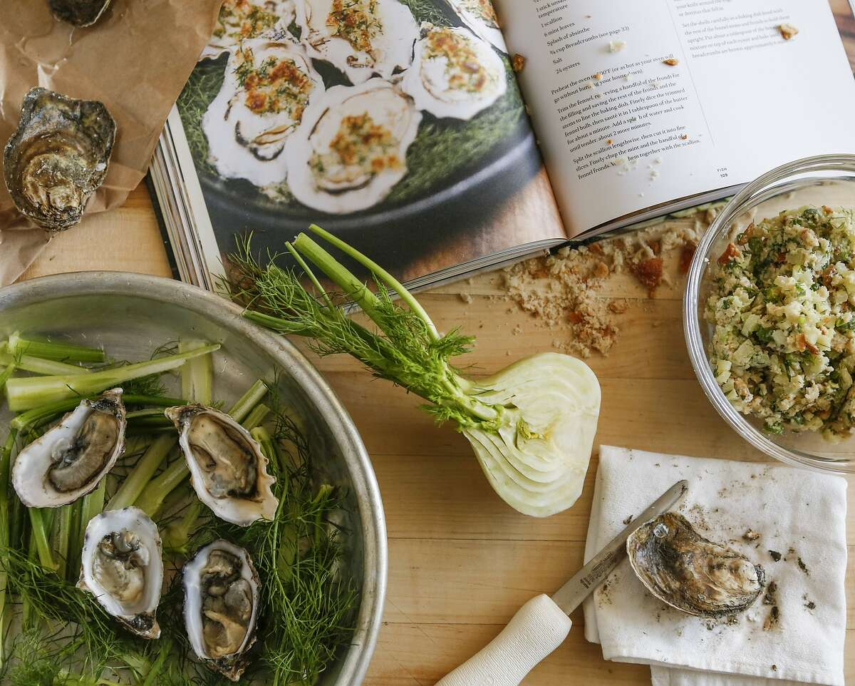 """Ingredients for baked oysters and the, """"This is Camino,"""" cookbook are seen on Wednesday, Nov. 18, 2015 in San Francisco, Calif."""