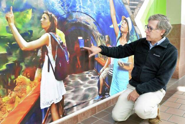 Marine biologist David Gross, the newly named director of the aquarium to be built inside Rotterdam Square Mall uses a poster to explain some of the features of their project at the mall Wednesday Nov. 18, 2015 in Rotterdam, NY.  (John Carl D'Annibale / Times Union) Photo: John Carl D'Annibale / 10034319A