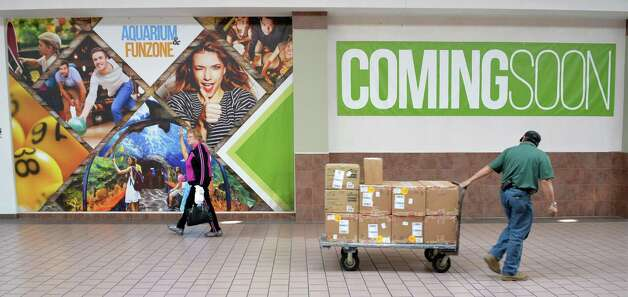 Posters announcing the new aquarium and fun zone  to be built inside Rotterdam Square Mall at the mall Wednesday Nov. 18, 2015 in Rotterdam, NY.   (John Carl D'Annibale / Times Union) Photo: John Carl D'Annibale / 10034319A