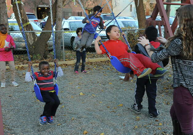 Children play on a playground during an after-school program for refugee children at the Refugee and Immigration Support Services of Emmaus (RISSE) classroom on Monday, Nov. 9, 2015 in Albany, N.Y.  (Lori Van Buren / Times Union) Photo: Lori Van Buren / 00034133A