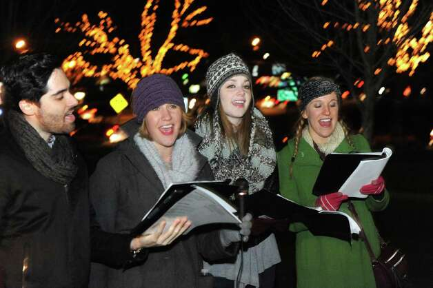 Park Playhouse actors, left to right, Michael Wessells, Meredith Myers, Emma Kron-deacon and Julia Franklin sing carols as Stuyvesant Plaza held their first holiday tree lighting ceremony on Wednesday Nov.18, 2015 in Albany, N.Y.  (Michael P. Farrell/Times Union) Photo: Michael P. Farrell / 10034313A