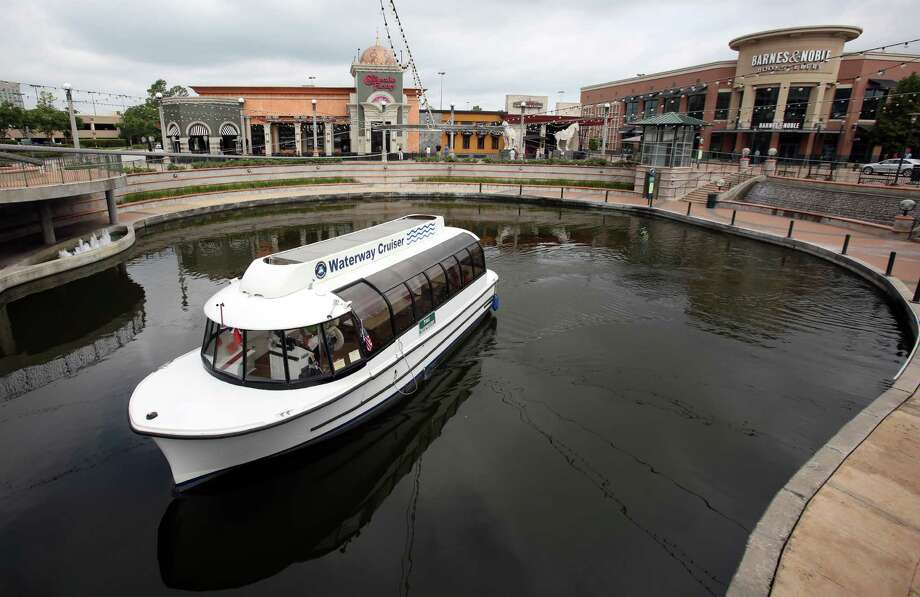 A water cruiser completes a loop of The Woodlands Waterway near The Woodlands Mall. Photo: Mayra Beltran, Staff / Â 2014 Houston Chronicle