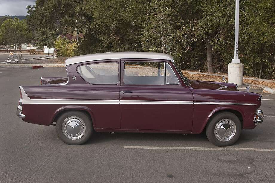 Photos of John Ralston and his 1966 Ford Super Anglia 123e. With the 1200cc engine, photographed at Foothill Communitiy College off El Monte Road on October 18, 2015. Photo: Stephen Finerty, Photograph By Stephen Finerty -