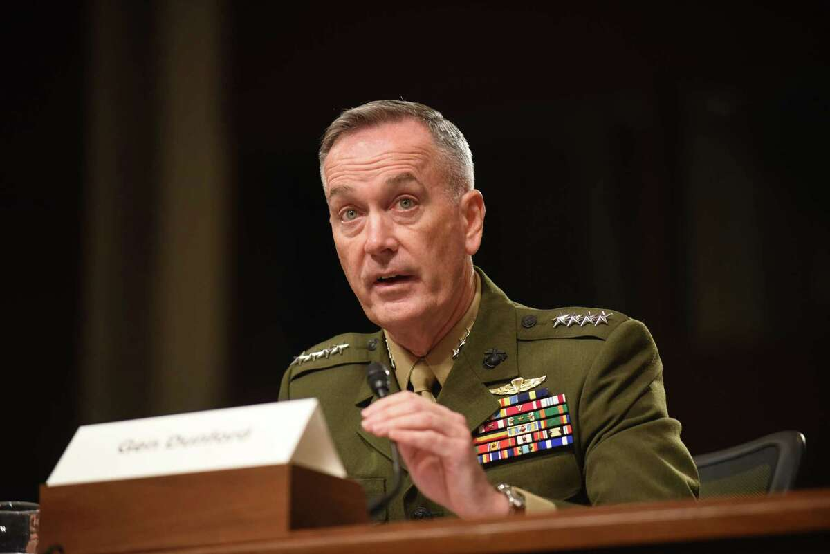 FILE - In this Oct. 27, 2015 file photo, Joint Chiefs Chairman Gen. Joseph Dunford, Jr. testifies on Capitol Hill in Washington. In measuring progress in the American-led air war against the Islamic State in Syria and Iraq, numbers tell one story, but results tell another. Fighter jets, bombers, attack planes and drones are dropping an average of 2,228 bombs per month on targets ranging from militant snipers and machine gun positions to oil facilities, weapon storage shacks, bulldozers and buildings. The attacks have killed upward of 20,000 Islamic State fighters. (AP Photo/Kevin Wolf, File) ORG XMIT: WX108