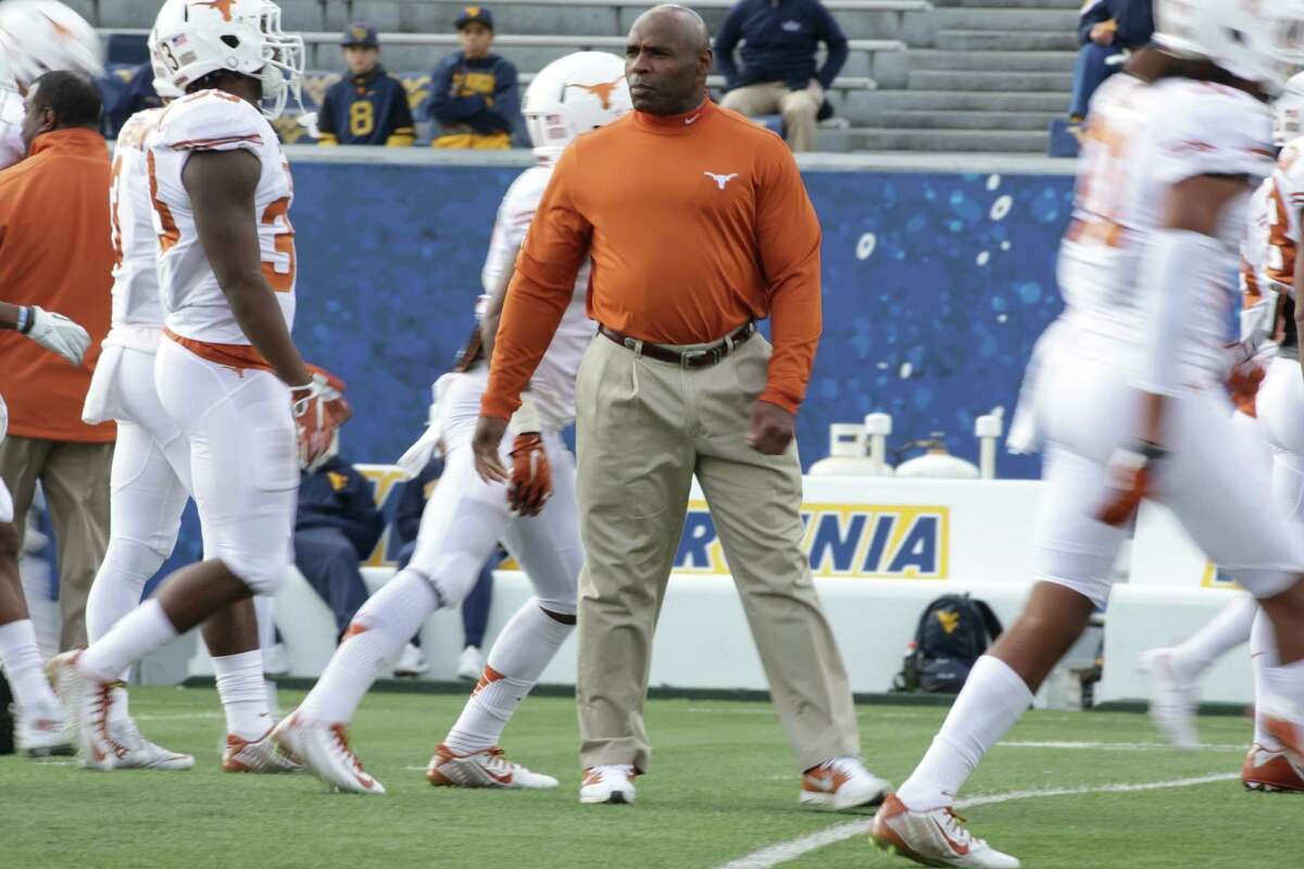 Texas head coach Charlie Strong prepares for the second half against West Virginia on Nov. 14, 2015, in Morgantown.