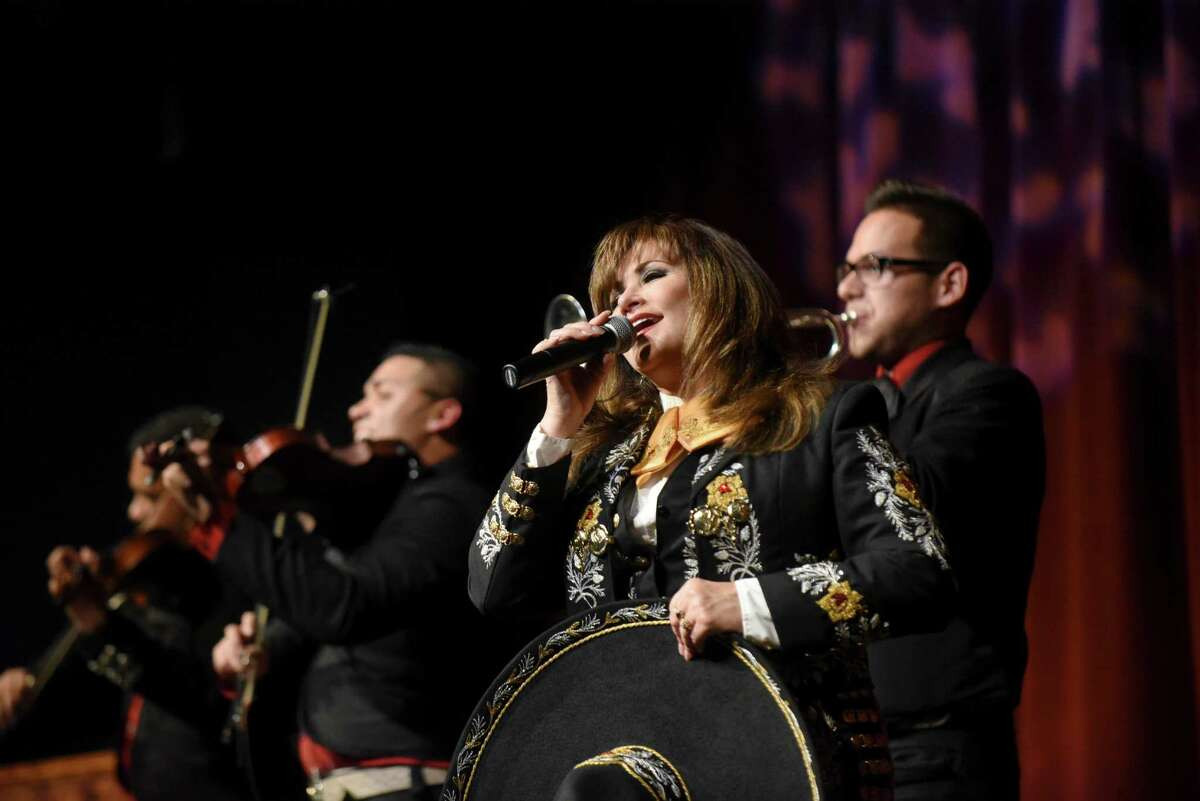 San Antonio College Alumnus Dr. Patsy Torres is joined by Mariachi Nuevo Estilo AVM during the San Antonio College 90th Anniversary Showcase at McAllister Auditorium on Wednesday night, Nov. 18, 2015. Several SAC alumni, including television personality Michael Valdes, and aerialist Marshall Jarreau performed at the event. San Antonio College was founded in 1925 as University Junior College.