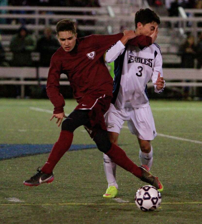Bethel's Nicholas Osebio and Wethersfield's Brian Vieira battle for the ball midfield in a CIAC Class L semi final boys soccer game on Nov. 18, 2015 in Waterbury. Bethel lost to Wethersfield 3-1. Photo: Matthew Brown / For Hearst Connecticut Media / Connecticut Post Freelance