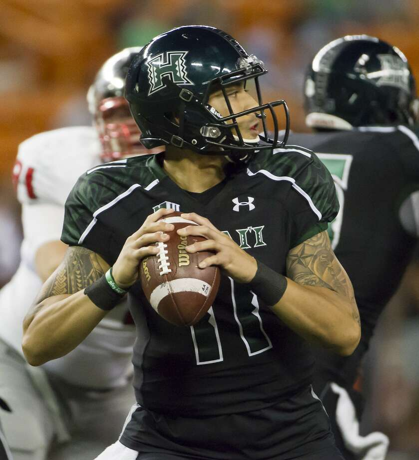 Hawaii quarterback Ikaika Woolsey looks for a receiver during the second quarter of an NCAA college football game against Fresno State, Saturday, Nov. 14, 2015, in Honolulu. (AP Photo/Eugene Tanner) Photo: Eugene Tanner, Associated Press