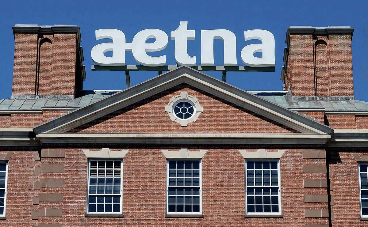 A sign stands at Aetna headquarters in Hartford, Conn. On Wednesday, Nov. 18, 2015, a Vermont insurance broker was sentenced to three years in jail for stealing more than $10 million from the insurance giant.