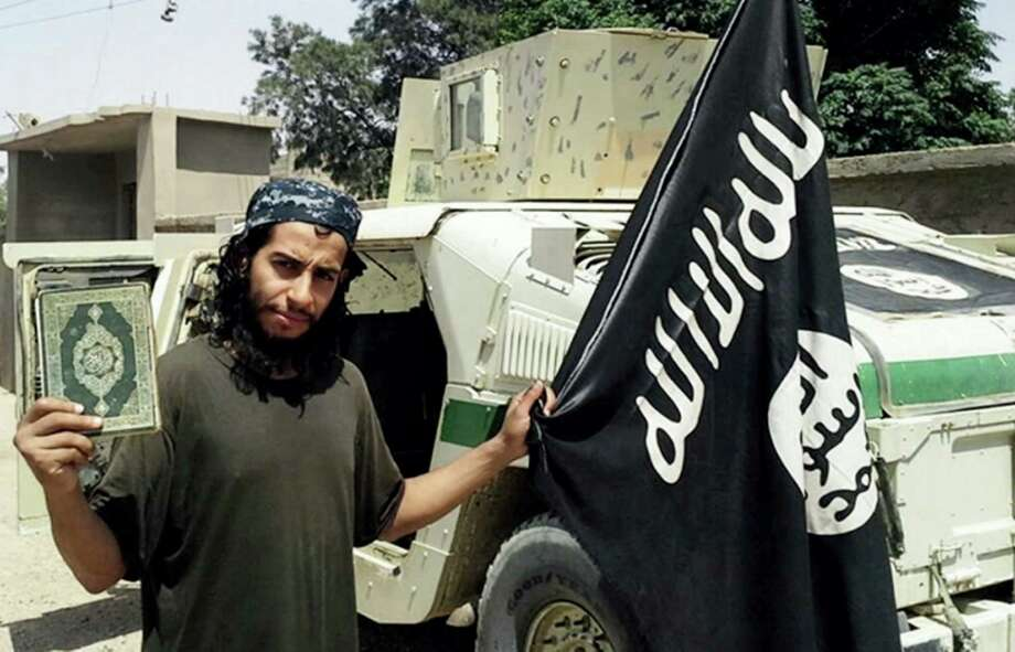 This undated image made available in the Islamic State's English-language magazine Dabiq, shows Belgian Abdelhamid Abaaoud. . Abaaoud the Belgian jihadi suspected of masterminding deadly attacks in Paris was killed in a police raid on a suburban apartment building, the city prosecutor's office announced Thursday Nov. 1, 2015. Paris Prosecutor Francois Molins' office said 27-year-old Abdelhamid Abaaoud was identified based on skin samples. His body was found in the apartment building targeted in the chaotic and bloody raid in the Paris suburb of Saint-Denis on Wednesday. (Militant photo via AP) Photo: Uncredited, AP / Militant Website