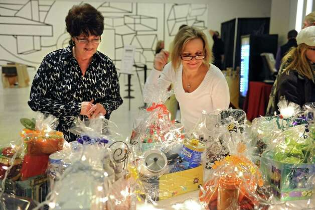 Vicki Andrews of Alplaus, left, and Beth Sweeney of Albany look at gift ideas during the Harvest Festival at the Concourse of the Empire State Plaza on Wednesday, Nov. 18, 2015 in Albany, N.Y.  (Lori Van Buren / Times Union) Photo: Lori Van Buren / 00034250A