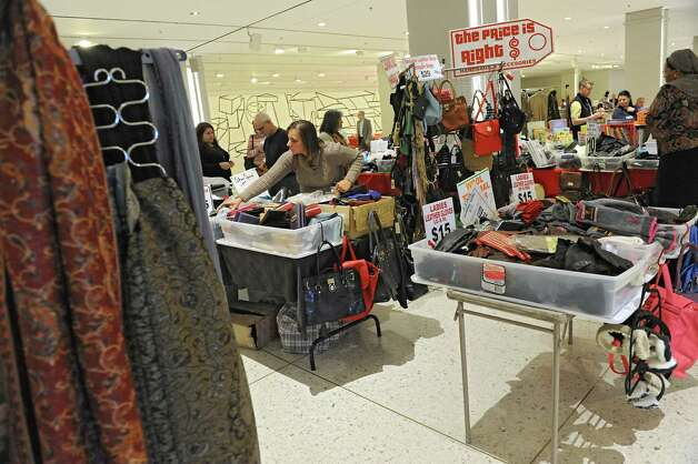 People browse for goods during the Harvest Festival at the Concourse of the Empire State Plaza on Wednesday, Nov. 18, 2015 in Albany, N.Y.  (Lori Van Buren / Times Union) Photo: Lori Van Buren / 00034250A