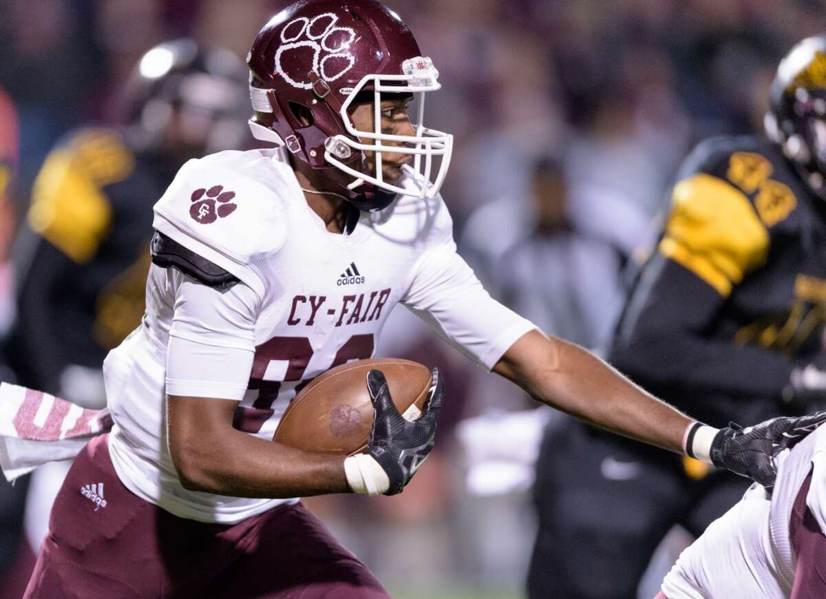 Eisenhower 36, Cy-Fair 28 B.J. Chambers (80) of the Cy-Fair Bobcats runs for a short gain after a reception in the first half against the Eisenhower Eagles in a high school football game on Saturday, November 14, 2015 at Thorne Stadium.