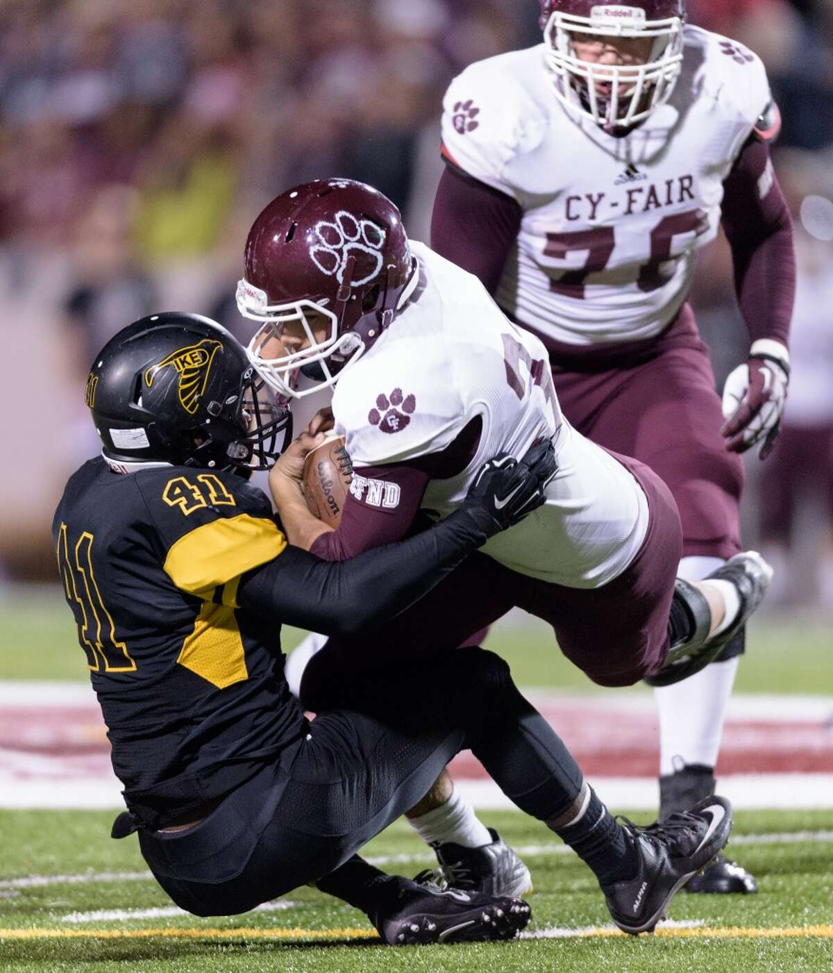 Blake Faecher (32) of the Cy-Fair Bobcats is brought down by Earnest Anderson (41) of the Eisenhower Eagles after a short gain in the first half of a high school football game on Saturday, November 14, 2015 at Thorne Stadium.