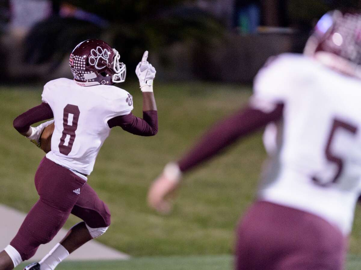Erick Hallett (8) of the Cy-Fair Bobcats scores a touchdown after he recovered a teammates fumble on a kickoff in the first half against the Eisenhower Eagles in a high school football game on Saturday, November 14, 2015 at Thorne Stadium.