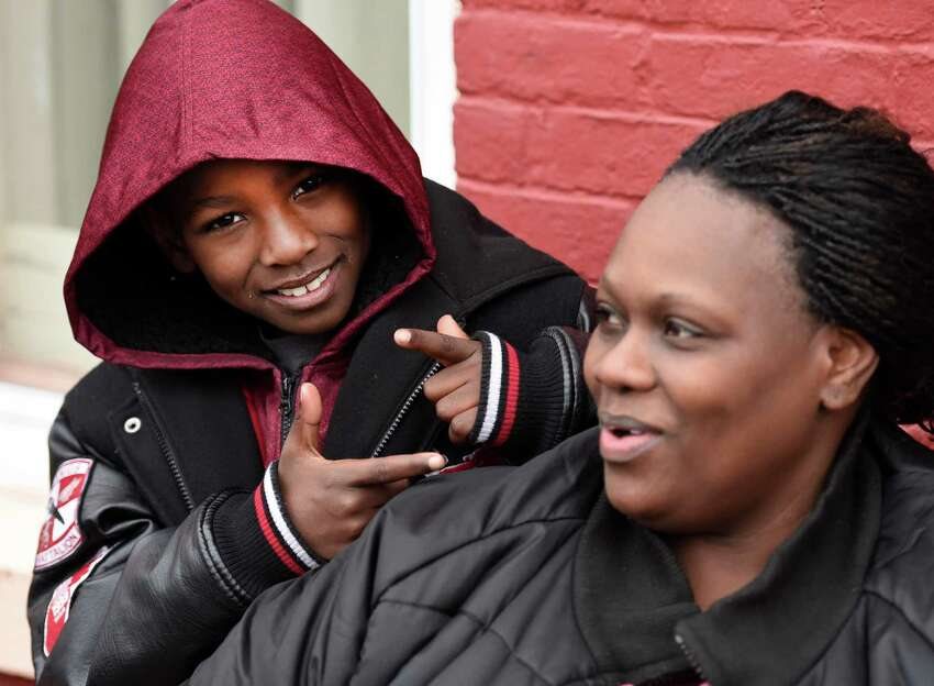Avery Moses, 6, enjoys a fun moment with his mother Lynette Moses Thursday morning Nov. 19, 2015 after he saved numerous lives by alerting his family to the smell of smoke at his home at 50 Broad Street in Albany, N.Y. (Skip Dickstein/Times Union)