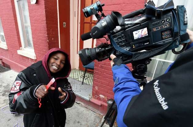Avery Moses, 6, hams it up with a television cameraman Thursday morning Nov. 19, 2015 after he saved numerous lives by alerting his family to the smell of smoke at his home at 50 Broad Street in Albany, N.Y.     (Skip Dickstein/Times Union) Photo: SKIP DICKSTEIN