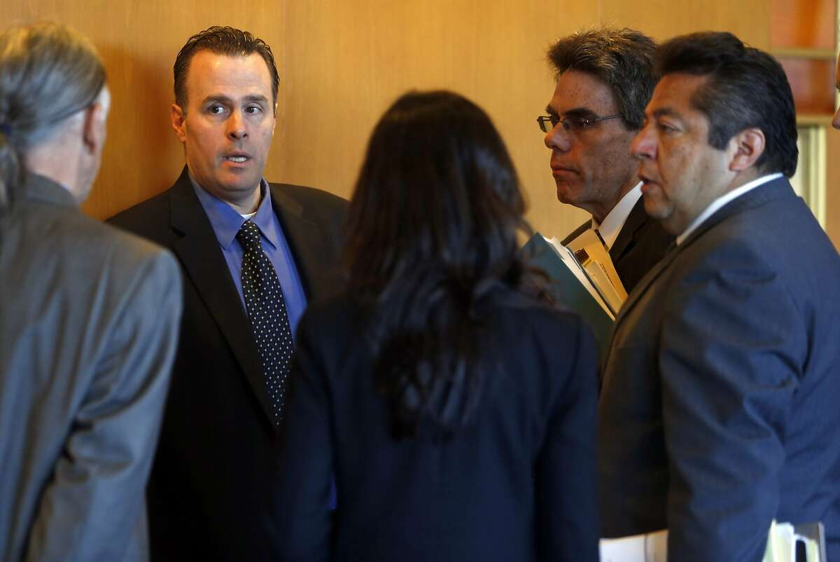 Marin County Deputy District Attorney Leon Kousharian (second from left) confers with Marin County Chief Deputy Public Defender David Brown (second from right) and Marin County Deputy Public Defender Pedro Oliveros (right) before arraignment for Morrison Haze Lampley, Lila Scott Alligood and Sean Michael Angold, the three drifters that are accused of murder. Photographed at Marin County Superior Court in San Rafael, Calif., on Thursday, November 19, 2015.