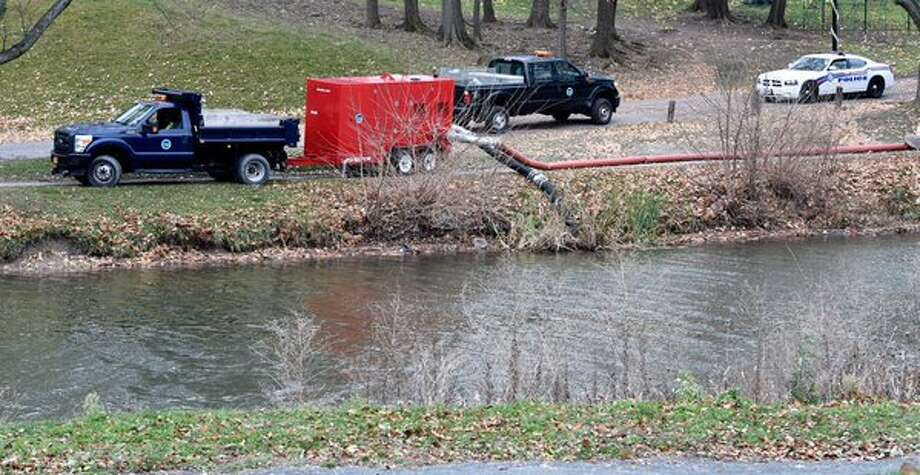 The level of Washington Park Lake in Albany, NY, is being lowered on Thursday, Nov. 19, 2015, for divers to search for a knife believed use to kill Jacquelyn Porreca in August in Colonie. (Skip Dickstein/Times Union)