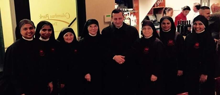 Bishop Frank Caggiano and members of the Little Workers of the Sacred Hearts at a Nov. 7 fundraiser at Columbus Park Trattoria in Stamford. Photo: Contributed / Contributed / Stamford Advocate Contributed