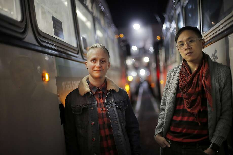 Ariel Dunitz-Johnson, left, and Phillip Hua, right, at the Muni Presidio Division yard in San Francisco, Calif., on Thursday, November 19, 2015. Hua and Dunitz-Johnson are artists who have portraits inside 10 muni buses on lines all over the city. It's part of a program sponsored by San Francisco Beautiful to replace the ads with artwork on 50 buses a day. Photo: Carlos Avila Gonzalez, The Chronicle