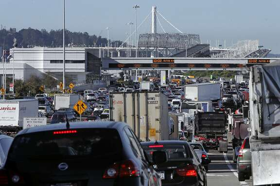 The morning commute traffic backed up on the West Grand Avenue approach to the Bay Bridge, in Oakland, Calif.,  on Thurs. November 19, 2015.