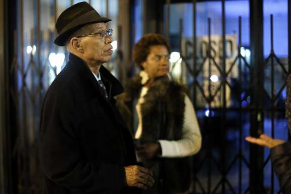 Del Seymour and Sonja Scott wait for the rest of the group to catch up during Progressive party in The Tenderloin in San Francisco, Calif., on Wednesday, November 18, 2015.