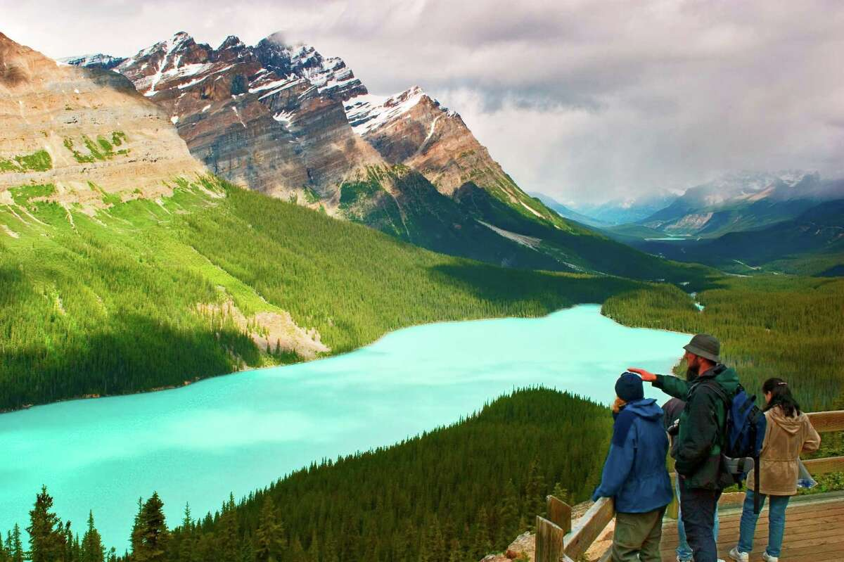 Tourists on the observation deck overlooking Peyto Lake on the Ice fields Parkway in Banff National Park.