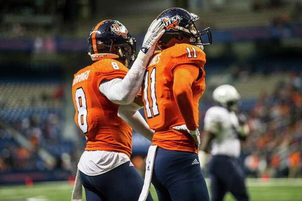 UTSA's Michael Egwuagu, left, comforts Nate Gaines after a touchdown pass went to the man Gaines was defending during UTSA's game against Old Dominion at the Alamodome in San Antonio on Saturday, November 7, 2015.