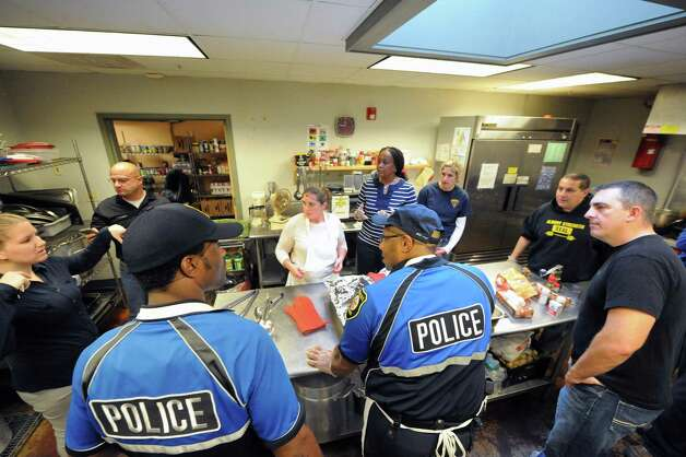 Albany police personnel and other volunteers cooked and served a pasta lunch to residents at the Interfaith Partnership for the Homeless on Thursday Nov. 19, 2015 in Albany, N.Y.  All food was donated by Hannaford Supermarkets. (Michael P. Farrell/Times Union) Photo: Michael P. Farrell / 10034368A