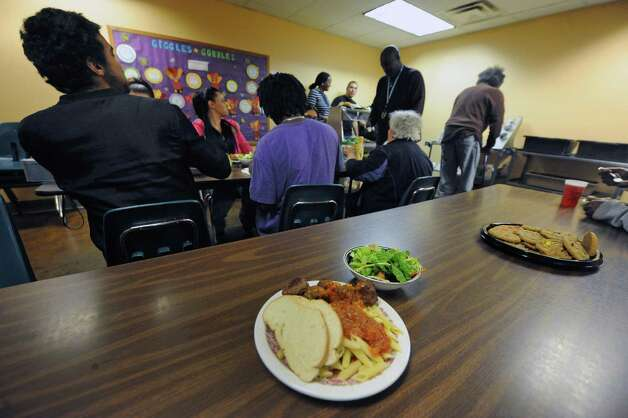 Albany police personnel served a pasta lunch to residence at the Interfaith Partnership for the Homeless on Thursday Nov. 19, 2015 in Albany, N.Y.  All food was donated by Hannaford Supermarkets. (Michael P. Farrell/Times Union) Photo: Michael P. Farrell / 10034368A