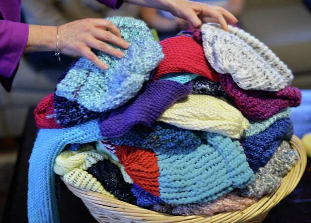 Some of the hats and scarves made by Living Resources Day Program participants for theShelters of Saratoga Thursday Nov. 19, 2015 in Saratoga Springs, NY.  (John Carl D'Annibale / Times Union) Photo: John Carl D'Annibale / 10034344A