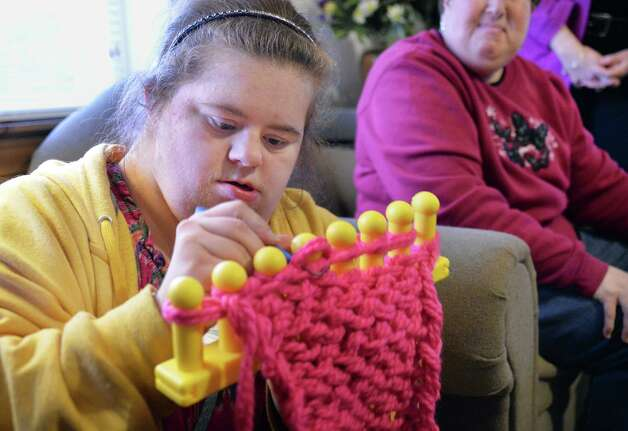 Living Resources Day Program participant Crystal Allen of Malta works on a scarf during a visit to Shelters of Saratoga as Living Resources presented Shelters with more than 50 hand-knit winter hats and scarves for the homeless Thursday Nov. 19, 2015 in Saratoga Springs, NY.  (John Carl D'Annibale / Times Union) Photo: John Carl D'Annibale / 10034344A