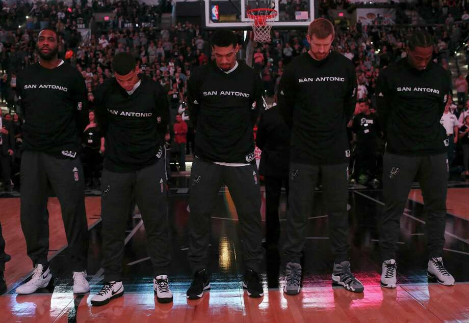 San Antonio Spurs' Danny Green, center, bows his head during the National Anthem before their game against the Denver Nuggets  at the AT&T Center, Wednesday, Nov. 18, 2015. Photo: JERRY LARA, Staff / San Antonio Express-News / © 2015 San Antonio Express-News
