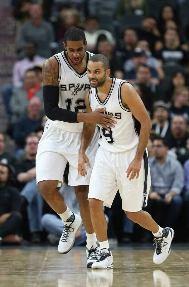San Antonio Spurs' LaMarcus Aldridge and Tony Parker celebrate a run during the second half against the Denver Nuggets at the AT&T Center, Wednesday, Nov. 18, 2015. The Spurs won, 109-98. Photo: JERRY LARA, Staff / San Antonio Express-News / © 2015 San Antonio Express-News