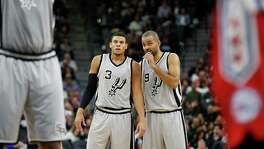 Spurs' Tony Parker (09) offers guidance to teammate Ray McCallum (03) during the game against the Philadelphia 76ers at the AT&T Center on Saturday, Nov. 14, 2015. (Kin Man Hui/San Antonio Express-News)