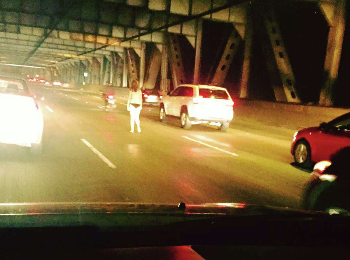 Treasure Island resident Tony Devencenzi captured this image of a partially naked woman walking on the Bay Bridge during the Wednesday evening commute.