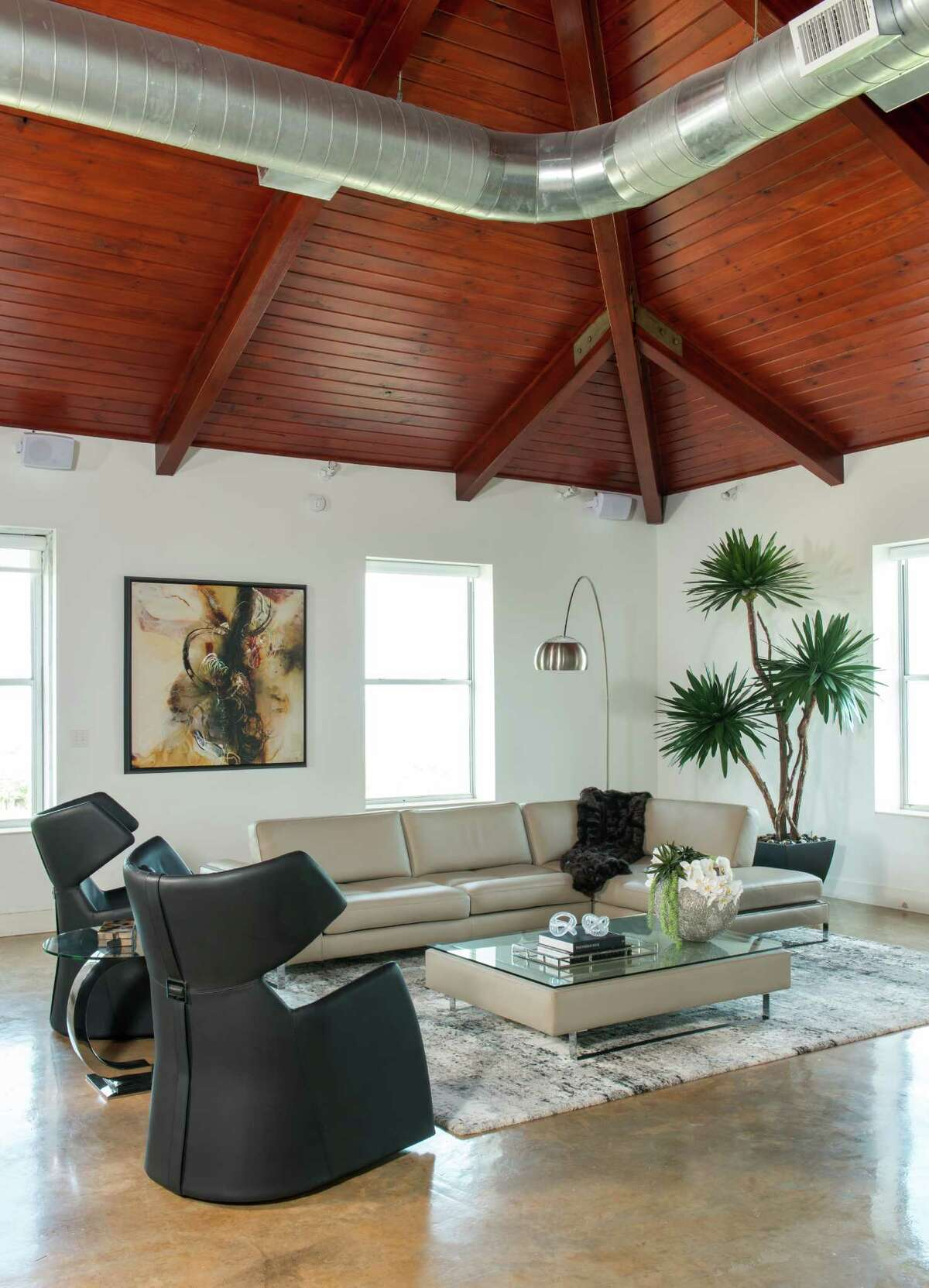 """The Seureaus' open living room is made cozy with two """"Snob"""" armchairs and a """"Treviso"""" sectional, both made by the Italian company Gamma Arredamenti."""