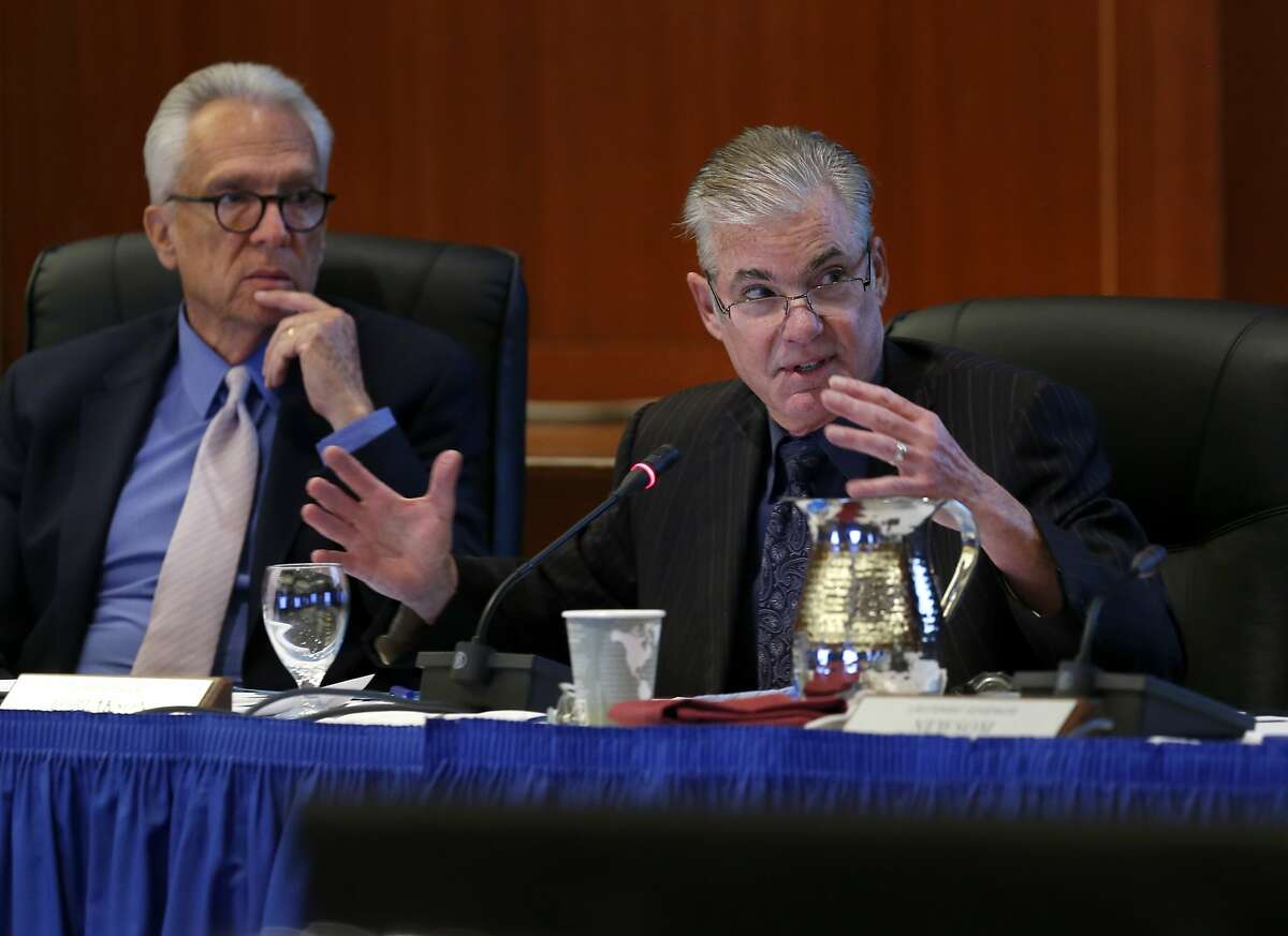 FILE-- Regent Norman Pattiz (left) listens as State Superintendent of Public Instruction Tom Torlakson comments on a proposed three-year financial stability plan during a meeting of the UC Board of Regents at the UCSF Mission Bay campus in San Francisco on Thursday, Nov. 19, 2015.