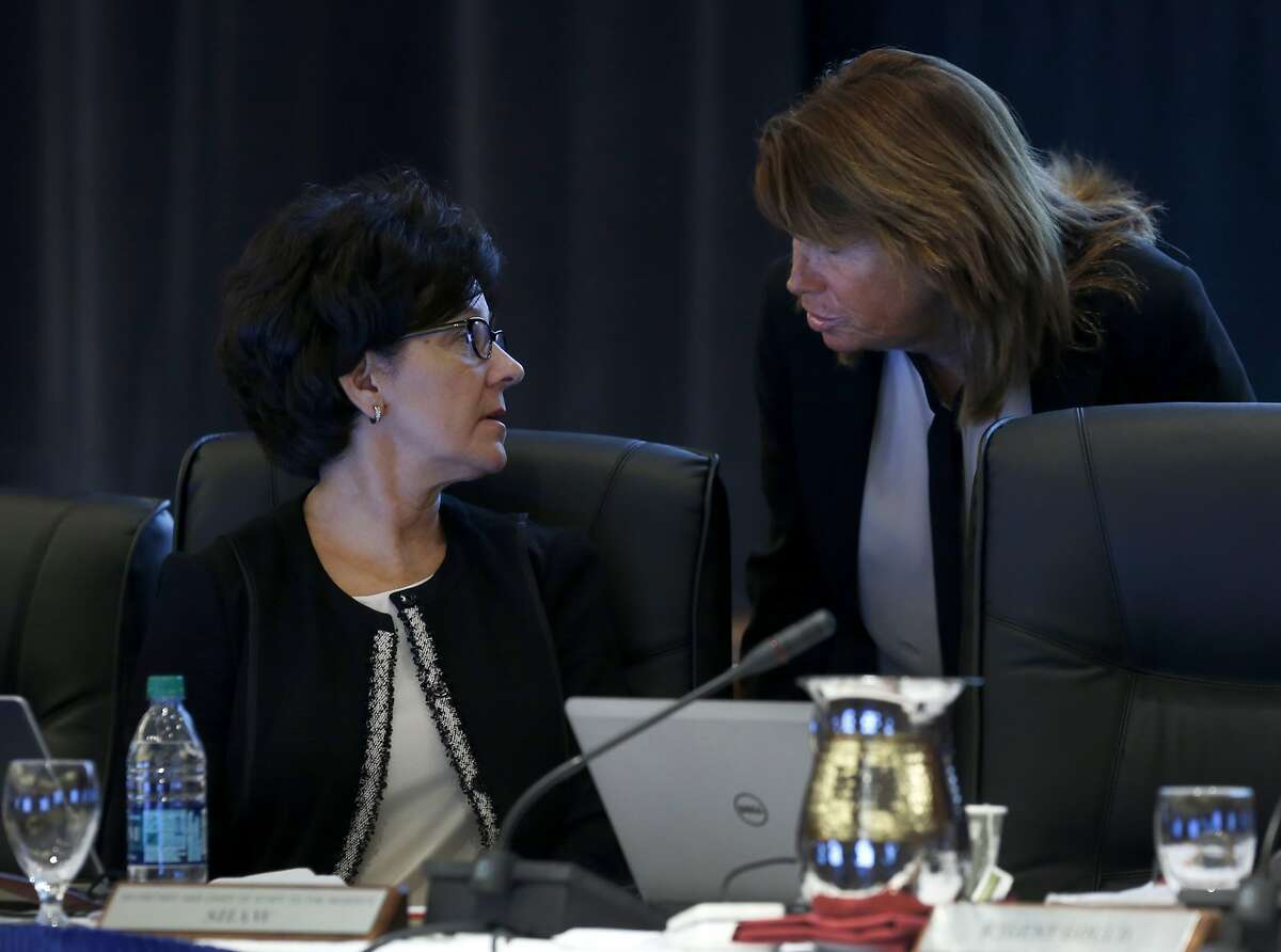 Regents Monica Lozano (left) and Bonnie Reiss confer during a meeting of the UC Board of Regents at the UCSF Mission Bay campus to discuss a three-year financial stability plan in San Francisco, Calif. on Thursday, Nov. 19, 2015.