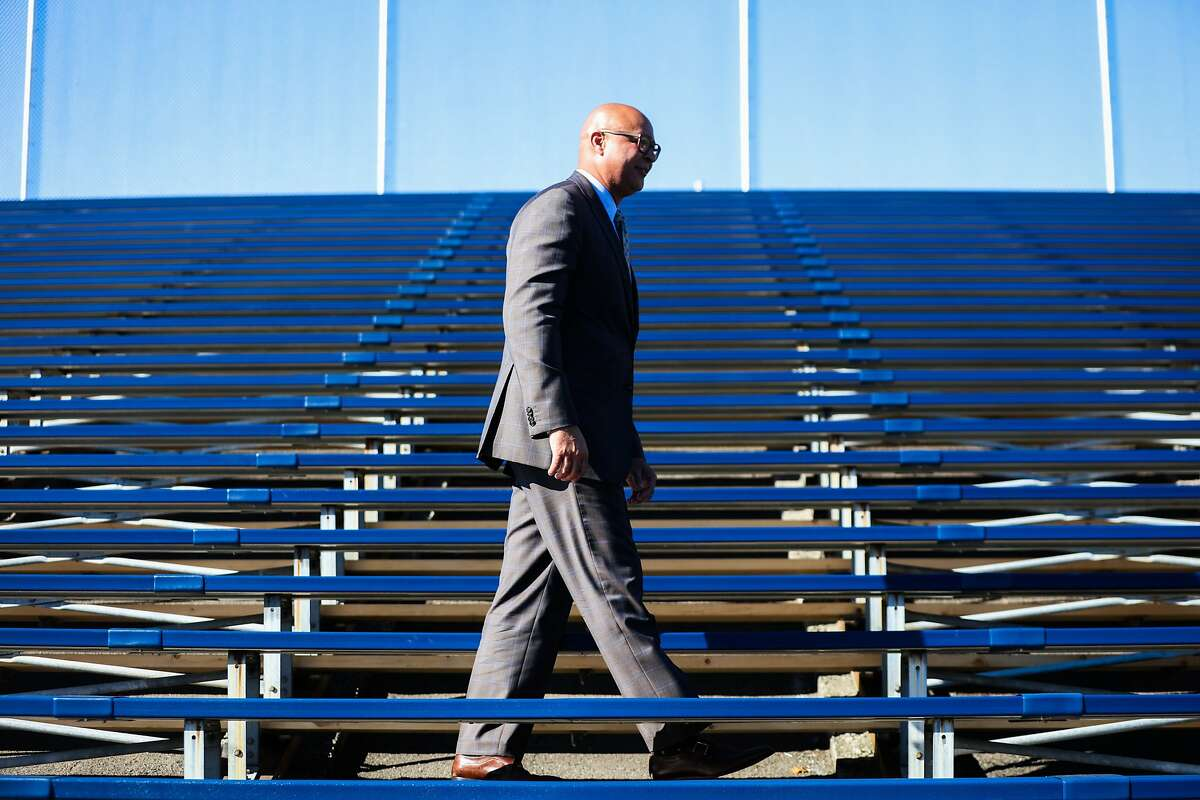 Lance Jackson, the interim facilities director of Oakland's Unified School District, walks through the newly renovated bleachers of Curt Flood Field, in Oakland, California on Thursday, November 19, 2015.