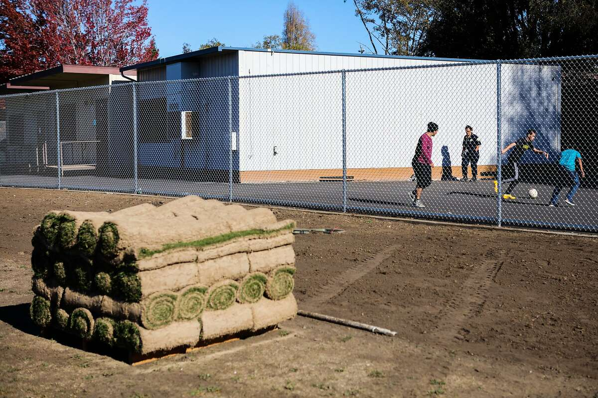 Students practice their soccer skills during recess at Oakland International High School, while the baseball field undergoes renovations, in Oakland, California, on Thursday, November 19, 2015.