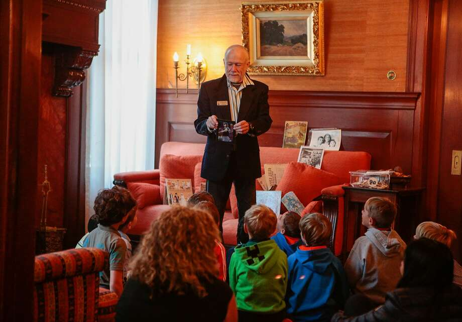 "Michael Bennett, above, volunteer docent at the Haas-Lilienthal House, guides children on a tour of the historic mansion, which has been repainted its original ""armored steel"" color, right. Photo: Nathaniel Y. Downes, The Chronicle"