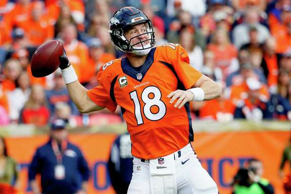 Denver Broncos quarterback Peyton Manning (18) throws during the first half of an NFL football game against the Kansas City Chiefs, Sunday, Nov. 15, 2015, in Denver. (AP Photo/Joe Mahoney)