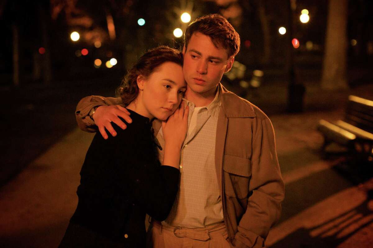 """This photo provided by Fox Searchlight shows, Saoirse Ronan, left, as Eilis Lacey and Emory Cohen as Tony, in a scene from the film, """"Brooklyn."""" The movie opens in U.S. theaters on Nov. 4, 2015. (Kerry Brown/Fox Searchlight via AP)"""
