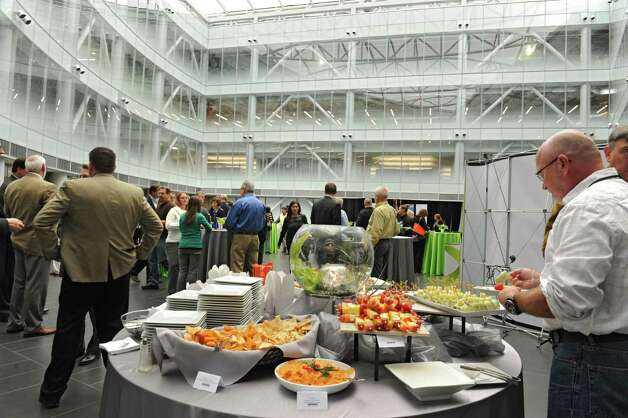 Guest mingle and enjoy food as SUNY Polytechnic Institute welcomes DPS Engineering of Ireland  to the ZEN building on Thursday, Nov. 19, 2015, in Albany, N.Y.  (Lori Van Buren / Times Union) Photo: Lori Van Buren / 10034355A