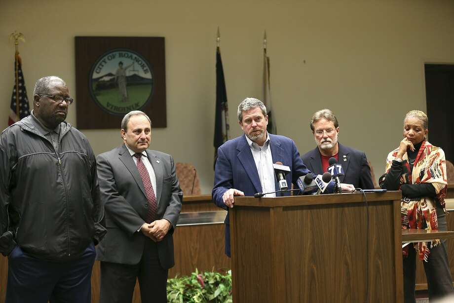Roanoke Vice Mayor David B. Trinkle, center, joined by council members from left, Sherman Lea, William D. Bestpitch, Raphael E. Ferris and Anita J. Price, speaks at a news conference, Wednesday Nov. 11, 2015, in Roanoke, Va., were they denounced comments that Mayor David Bowers made about Syrian refugees. Bowers has asked agencies to suspend relocating Syrian refugees to the area in the wake of the Paris terrorist attacks and other threats.  (Heather Rousseau/The Roanoke Times via AP) Photo: Heather Rousseau, Associated Press