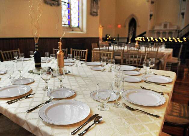 A table setting at Dan and Jennifer O'Neill's The Venue at St. Joseph's, a renovated church now an event space Wednesday Nov. 11, 2015 in Cohoes, NY.  (John Carl D'Annibale / Times Union) Photo: John Carl D'Annibale / 00034138A