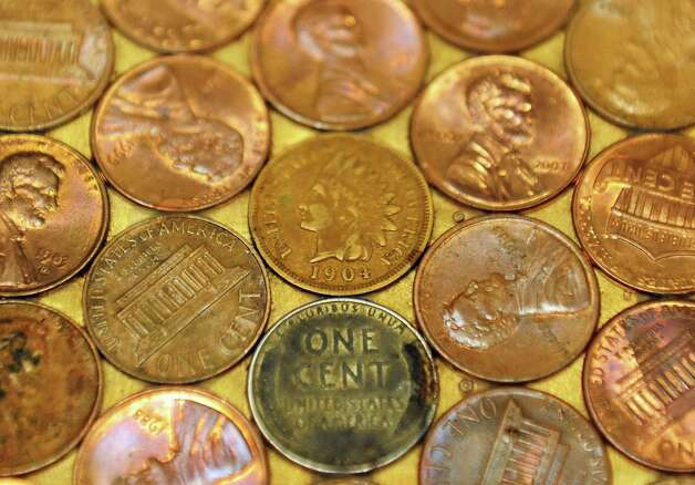 A layer of pennies form the surface of the lower level cocktail lounge's bar at Dan and Jennifer O'Neill's The Venue at St. Joseph's, a renovated church now an event space Wednesday Nov. 11, 2015 in Cohoes, NY.  (John Carl D'Annibale / Times Union) Photo: John Carl D'Annibale / 00034138A